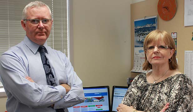 PAY WORRIES: Howick College business manager Mike Stanghan and accounts manager Marion Skelton have concerns over the end-of-year pay cycle and the deduction from wages for superannuation, student loans and KiwiSaver.