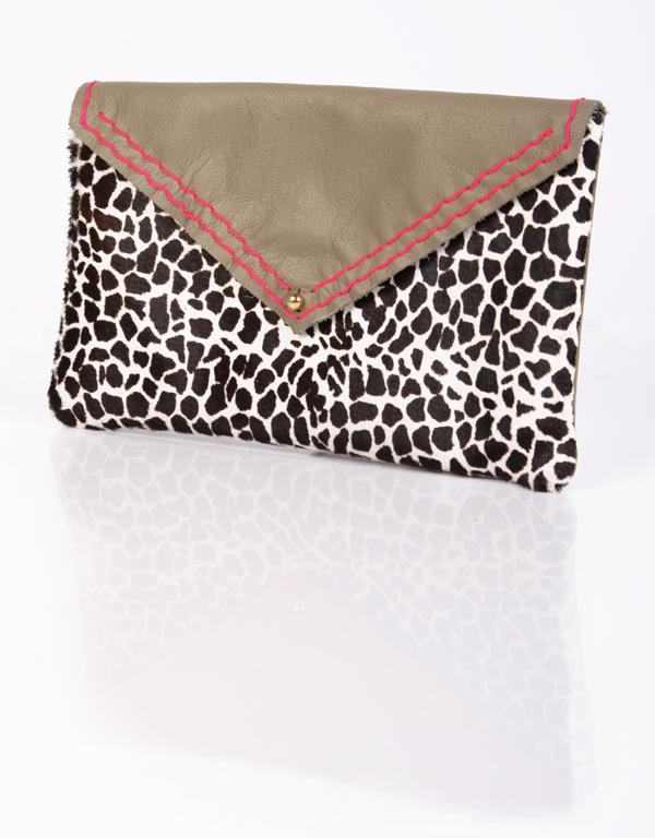 """Charlie Horse clutch, $169 from Superette. """"This leather and fur clutch by Charlie Horse makes me smile, I love the bold pink stitching."""""""