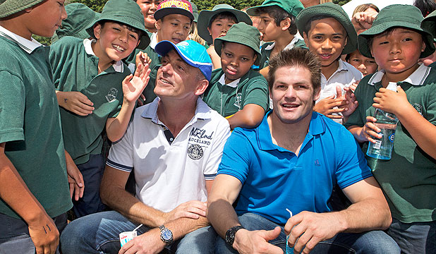 MILKY PROMISE: Fonterra ambassador Richie McCaw and students from Hillpark Primary in Manurewa celebrate the launch of Fonterra's milk in schools project.