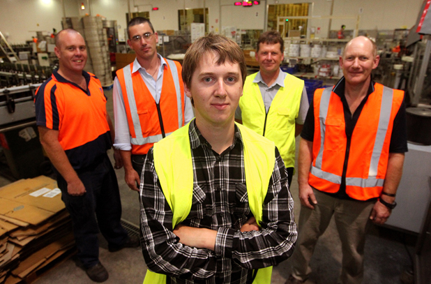 Prize winner: Blenheim man Matthew Vincent has won the inaugural $1000 engineering scholarship from wine bottling company WineWorks. Behind him are WineWorks employees, from left, Andrew Marshall, Peter Crowen and Michael Ford. NMIT programme area leader David White is in the yellow vest at  rear.