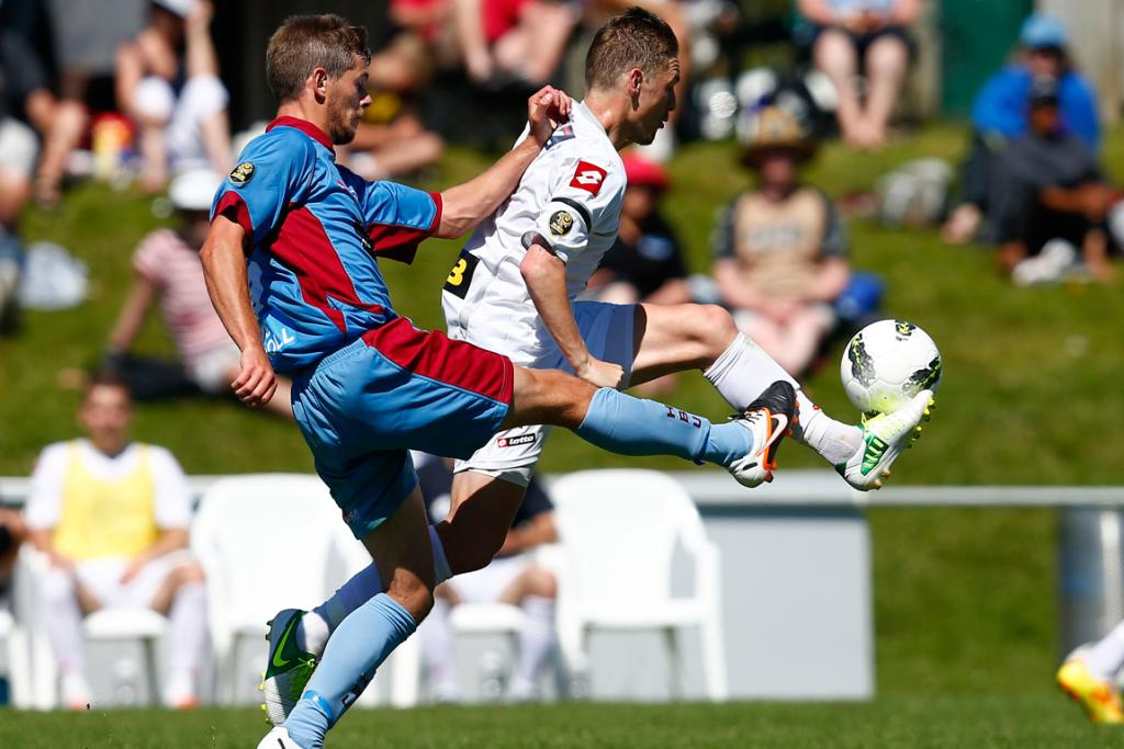 Waitakere's David Mulligan gets the edge on Bay's Stephen Hindmarch.