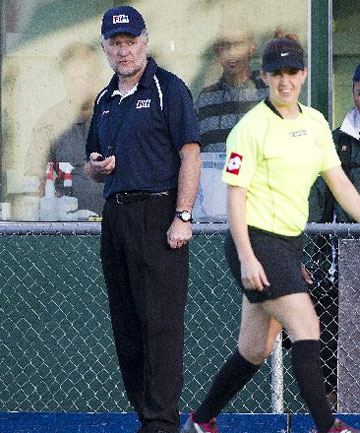 Manawatu's tournament director Jeff Brown keeps an eye on new international umpire Lucy Townend during last night's test at Fitzherbert Park.