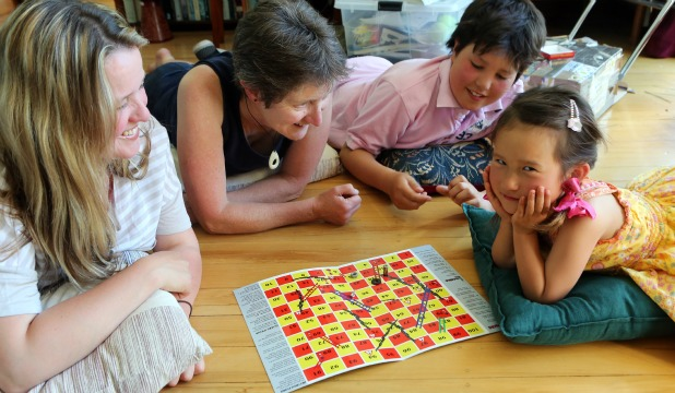 PRETEND TIME: Playing Quakes and Ladders are from left, Sonja Wegener, Jocelyn Paprall and Sonja's children, Lennart, 11, and Annabella, 5. They are neighbours of the game's designers.
