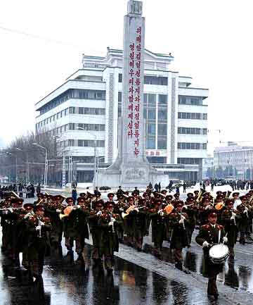 North Koreans attend a rally to celebrate the successful launch of the Unha-3 (Milky Way 3) rocket