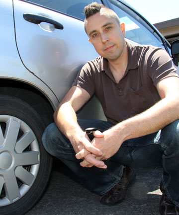 ALL FREE: Matt Sagen beside his car, which was clamped.