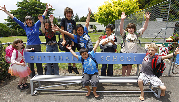 SCHOOL'S OUT, FOREVER: Whitehall School's last pupils went out with a smile. Zoe Dromgool, left, Mrs Maree Herbert (principal), Bryttany Lovich, William Thomas, Kawa Heta-Phillips, Tuata Heta-Phillips, Vincent Tipene, Fraser Kneebone and Jack Mitten.