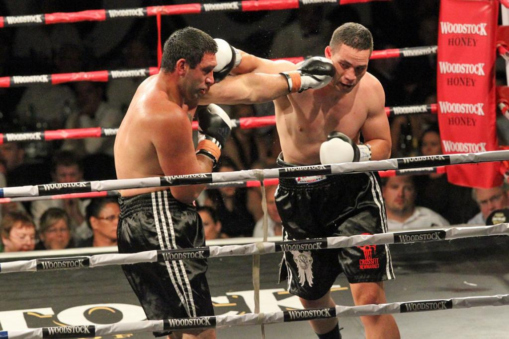 CHEEK TO CHEEK: Joseph Parker, left, and Richard Tutaki trade blows.