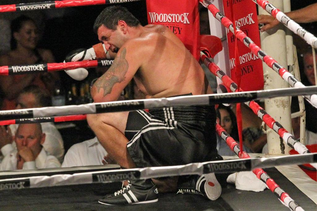 RESTING: Richard Tutaki takes a break during his fight with Joseph Parker.