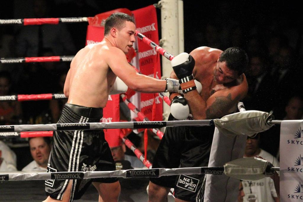 Joseph Parker lands a series of punches on Richard Tutaki during their short bout, won by Parker by TKO.