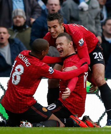 ON THE SCORESHEET: Wayne Rooney (centre) celebrates his goal with Ashley Young and Robin van Persie in Manchester United's 3-1 victory over Sunderland.