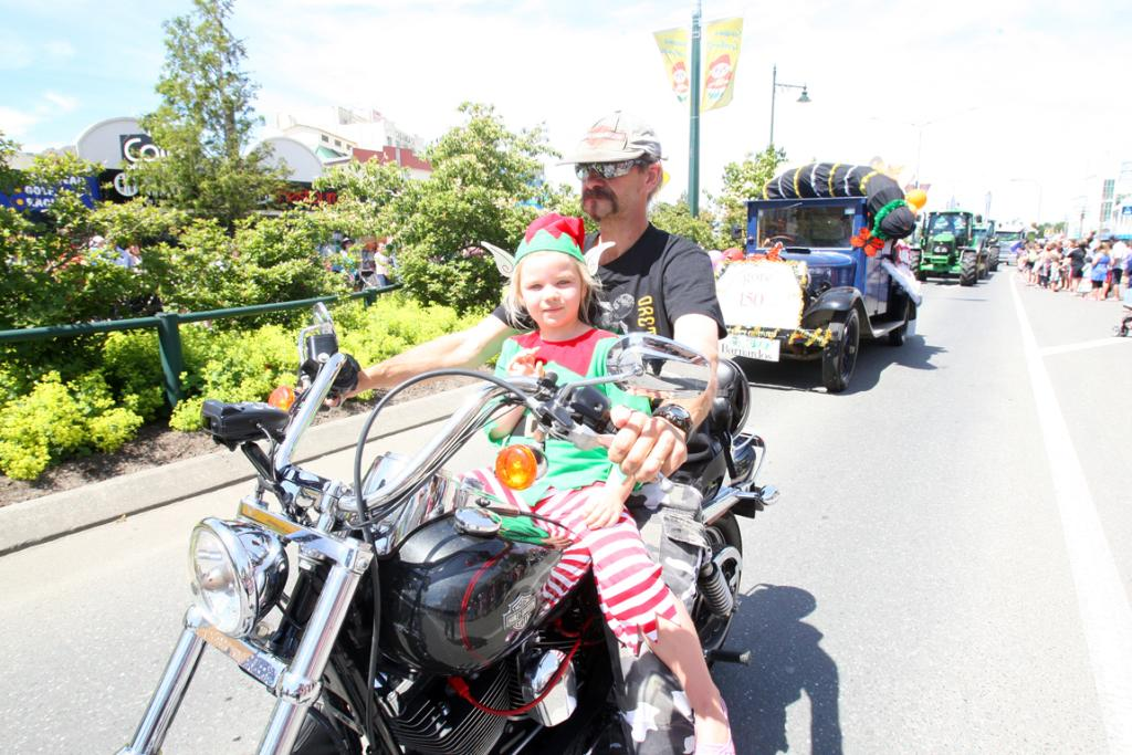 Tayla, 5, and Danny Glover ride in the Gore Santa Parade 2012.