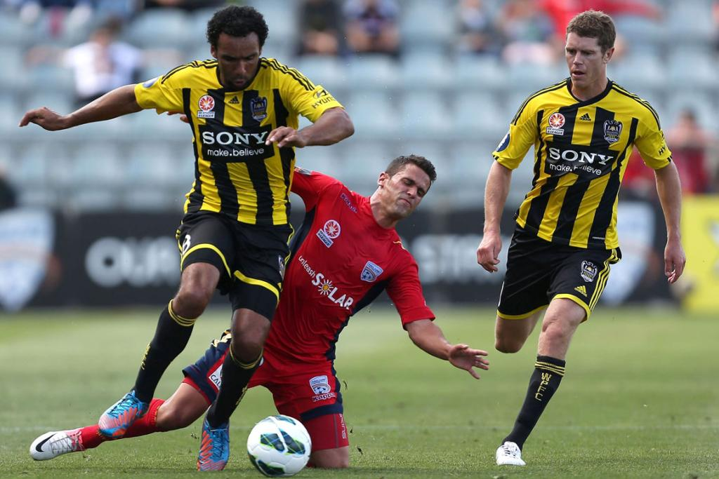 Paul Ifill of Phoneix is challenged by Fabio Ferreira of Adelaide during the match between Adelaide United and the Wellington Phoenix.