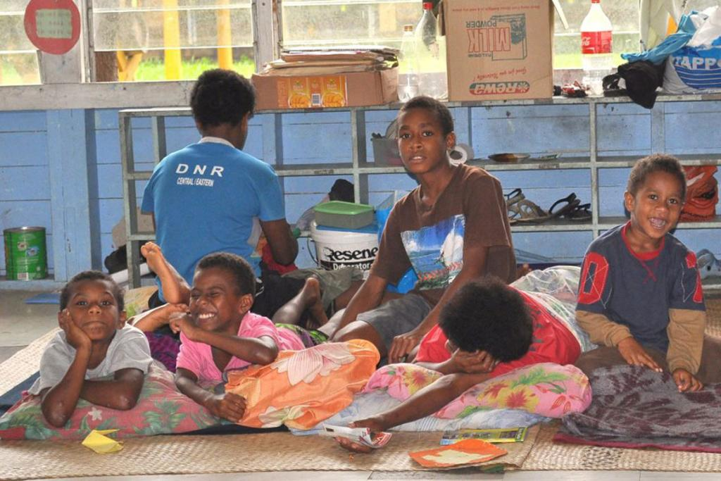 Spirits are high for some in Fiji as they take shelter from Cyclone Evan.
