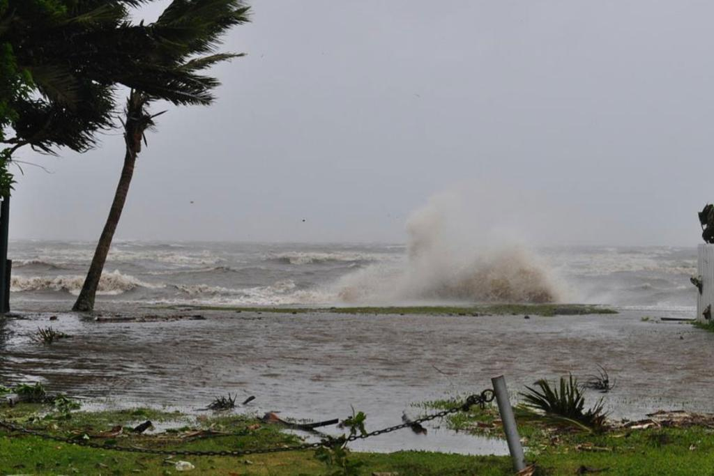 The sea crashes ashore as Cyclone Evan strikes Fiji.