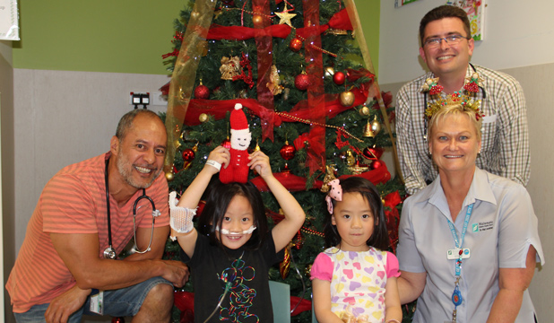 CHRISTMAS CHEER: Christmas is a big occasion this year for kids in the Rangatira ward. From left: Dr Meia Schmidt-Uili, Annemarie Wen, 6, Claudia Wen, 5, Rhonda Butler and Dr Chris Peterson.
