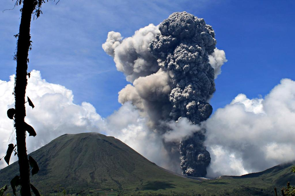 DECEMBER 18: Mount Lokon spews volcanic ash in an eruption in Indonesia's North Sulawesi province. It has erupted 800 times since July and this week's event saw hot lava and volcanic ash launched as high as 3000m.
