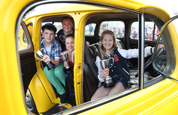 North Windsor School prizewinners, from left, Reuben Haywood, 11, Emma Riley, 11, Kate Loan, 10, and Alex-Helena Cope, 11, hang out in the bright yellow 1938 Chevrolet Master they arrived at school.