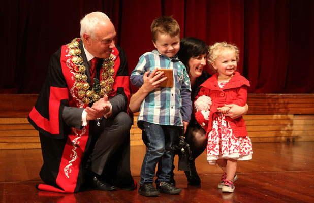 Jaime Gilbert's son Levi and daughter India receive his award from Christchurch Mayor Bob Parker