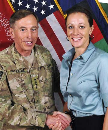 US General David Petraeus shakes hands with author Paula Broadwell in this ISAF handout photo from July 2011.