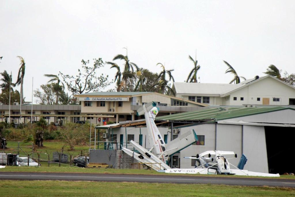 Damaged planes at an airport in Fiji.