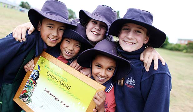 ENVIRO KIDS: Matthew Turner, Emily Cai, Erin Maclean, Hannah Dhanjee and Renee Hosking from Wakaaranga School with the Green-Gold  Enviroschools certificate.