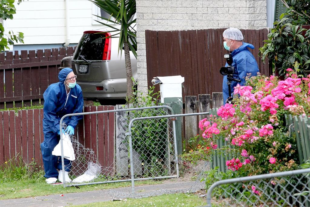 A police forensic team at the scene of a homicide investigation in Ranui, West Auckland.