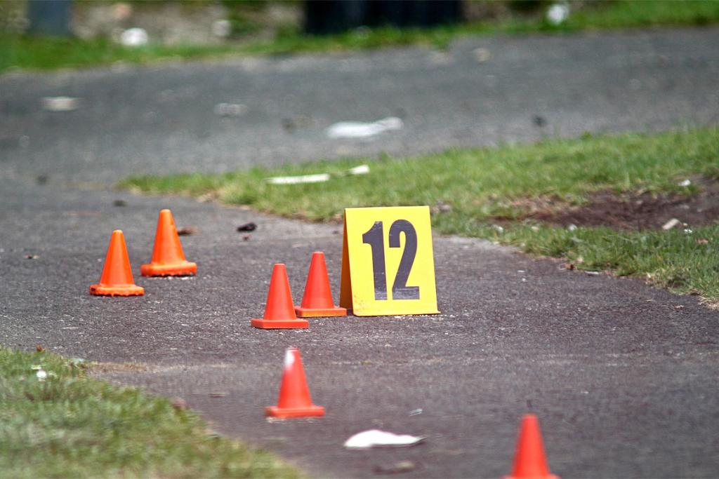 Markers cover the footpath as police investigate a 29-year-old man's death.