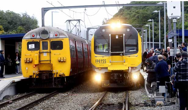 OUT WITH THE OLD: New Matangi trains (right) replace the old English Electric trains (left) on the Johnsonville line.