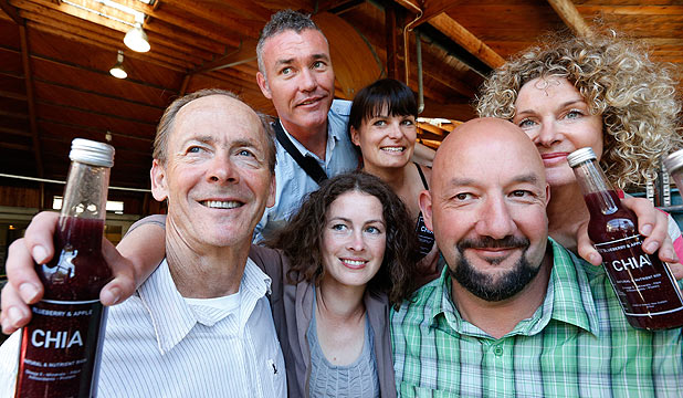 CHEERS: Chloe Van Dyke surrounded by the people who helped bring her Chia drink to reality [from left] Ben Van Dyke,Dean McCashin, Emma McCashin, Mark A'Court and Miranda Wood-Van Dyke at the McCashin's bottling plant in Stoke.