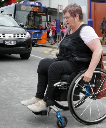 FRIGHTENING: Earthquake survivor Bev Edwards, who lost the use of her legs in the February 2011 quake, has frequently tumbled out of her wheelchair and been forced to ride along busy streets as she navigates Christchurch.