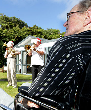 New Plymouth brass band members staged a surprise performance for retired life member Stewart Cowie