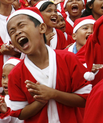 Children in Jakarta belt out their own renditions of popular carols.