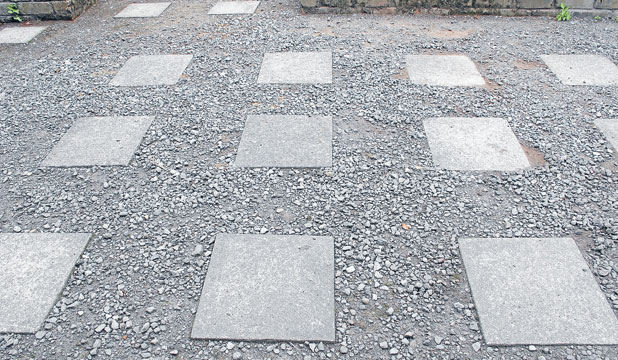 More interest: If you have a larger area to cover, placing pavers at regular intervals throughout a gravel area can add interest and style cheaply.