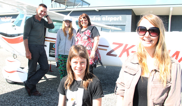 TO THE SKY: From left, Fly Alexandra pilot Nick Taylor, Bridget Price, 11, community liaison officer Raewyn Cockrane, Emma Borland, 12, front left, and Sarah Taal, 16, at Alexandra Airport yesterday before taking a flight above Alexandra and Clyde.