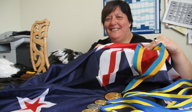 Gaining gold: Sonia Manaena has been named as The Eye's Newsmaker of the Year, the world champion sits in her office with her medal haul, award and national flag.