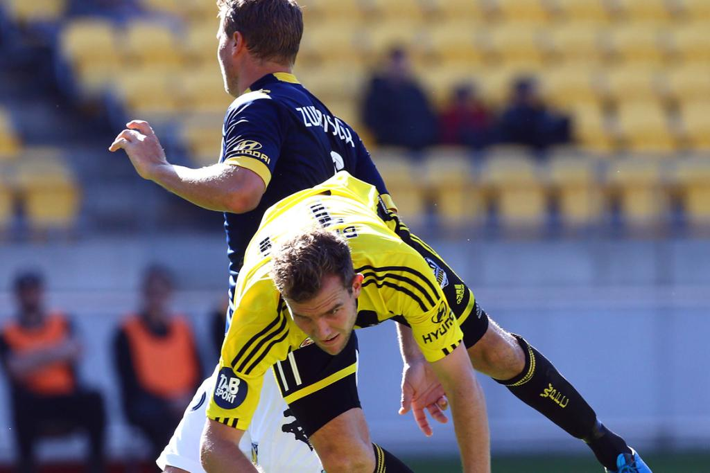 Jeremy Brockie takes a tumble during the match against Central Coast Mariners.