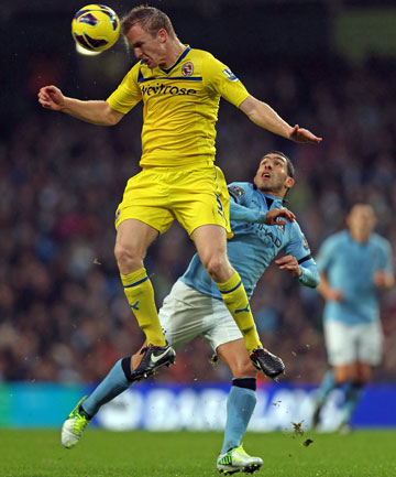 Alex Pearce and Carlos Tevez