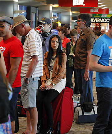 STUCK: Alexandra George waits in the queue of delayed passengers at Wellington airport.