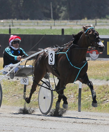 VICTORY, COME WHAT MAY: Ricky May and Ellmer Hanover power to victory in the Nat Hall Memorial race in Rangiora yesterday.