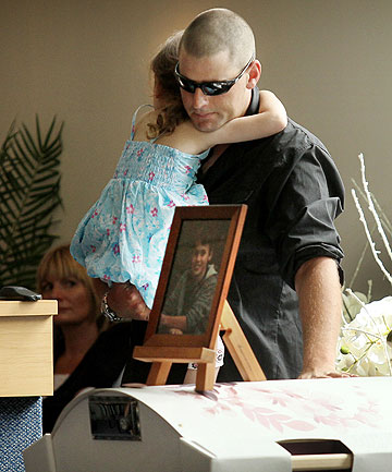 EMOTIONAL: Hamish Hartley and four-year-old daughter Zarah Hartley say their last farewell.