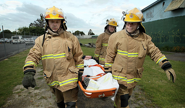 GROWING DEMAND: Ngaruawahia volunteer firefighters training for the growing number in medical-based callouts. Front L-R: Peter Humphreys and Howard Bettridge, back L-R: Shane Death, Darcy Robinson and Margaret Glassey (patient).