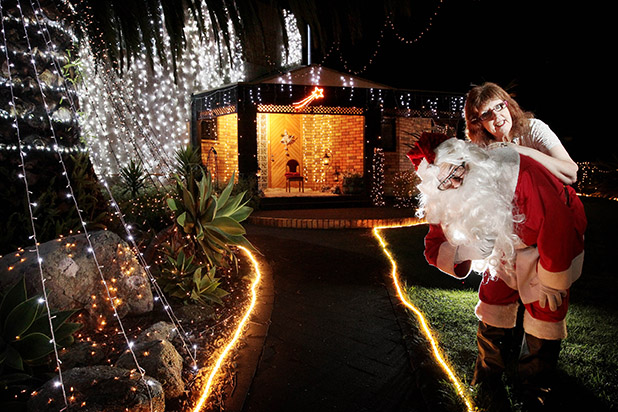 ALL IS BRIGHT: Bill Crook (Santa) and Kathy Wright-St Clair took out the Harrowfield Drive Christmas Lights Competition this year.