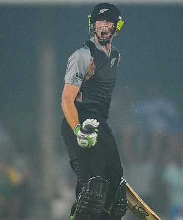 Martin Guptill hit the last ball for four to bring up a century and win the Twenty20 international against South Africa in East London.