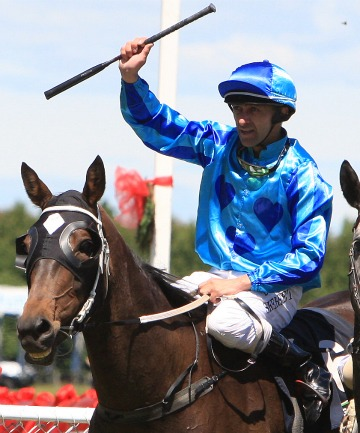 VICTORY: Darrin Skerrett gives a victory salute on Porotene Sky at Gore yesterday.