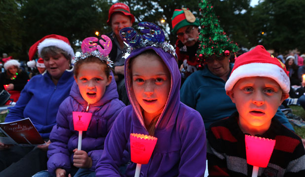 Showing good spirit, the McConnell family sings at Carols by Candlelight. From left: Sharon McConnell, Grace McConnell, 8, Blair McConnell, Jade McConnell, 9 Rodger and Lois Chapman and Quinn McConnell, 7.