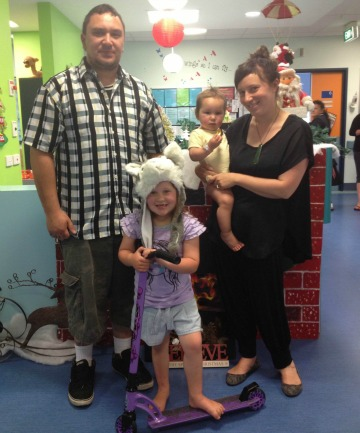 Jono Leask, his partner Sheena Manu and their daughters Alia, 5 (centre) and Imogen-Jade, 17 months. They are spending Christmas in hospital after Imogen-Jade suffered a seizure.