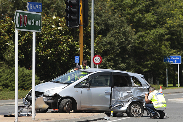 TRAGEDY: An elderly woman sitting in the rear of this car was killed when it and another car collided at the intersection of Te Rapa Rd and Avalon Dr yesterday.