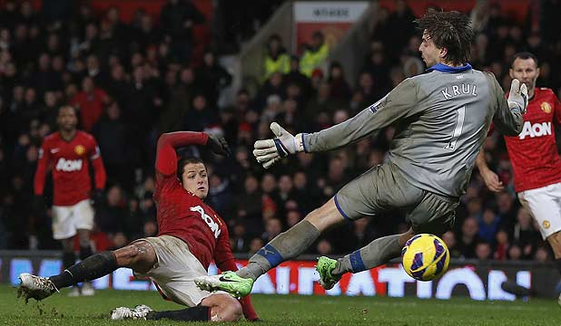 Manchester United's Javier Hernandez shoots past Newcastle United's Tim Krul to score the winning goal in their English Premier League football match at Old Trafford in Manchester.