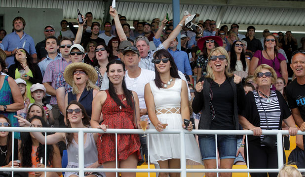 SOMETHING FOR EVERYONE: Excited racegoers cheer on their favourite horses at the Taranaki Daily News Family Fun Day at the  Pukekura Raceway yesterday.