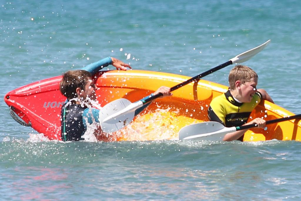 Harry Burgess, 16, and his brother Jack, 13, taken an unplanned dip on a sunny Riverton afternoon yesterday.